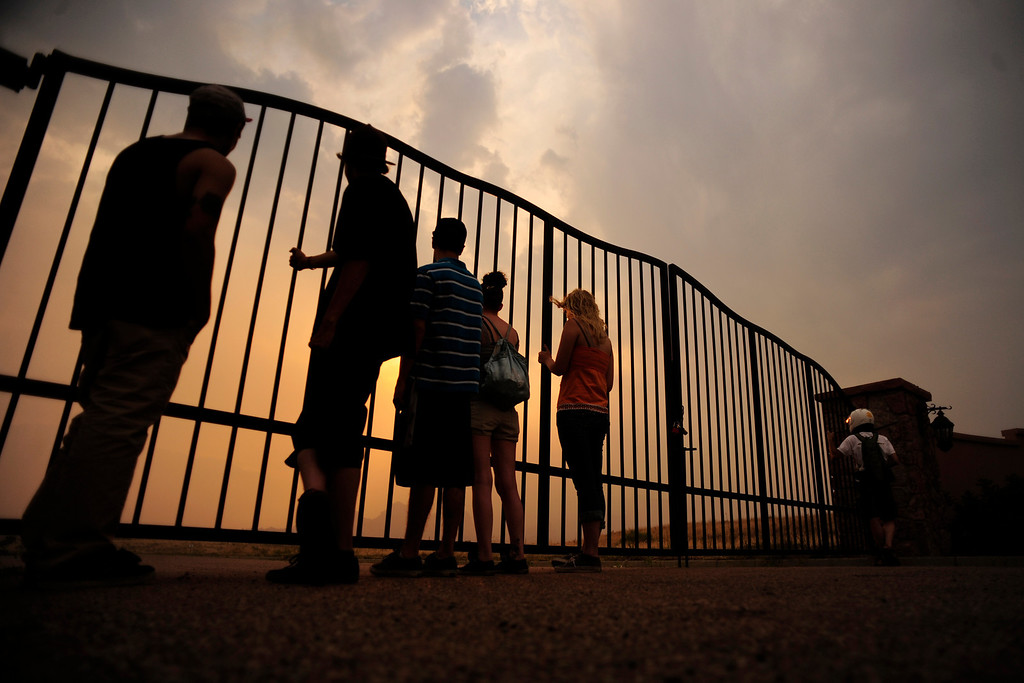 . A group of teens watch as the Waldo Canyon Fire burns outside of Colorado Springs on Sunday, June 24, 2012. AAron Ontiveroz, The Denver Post
