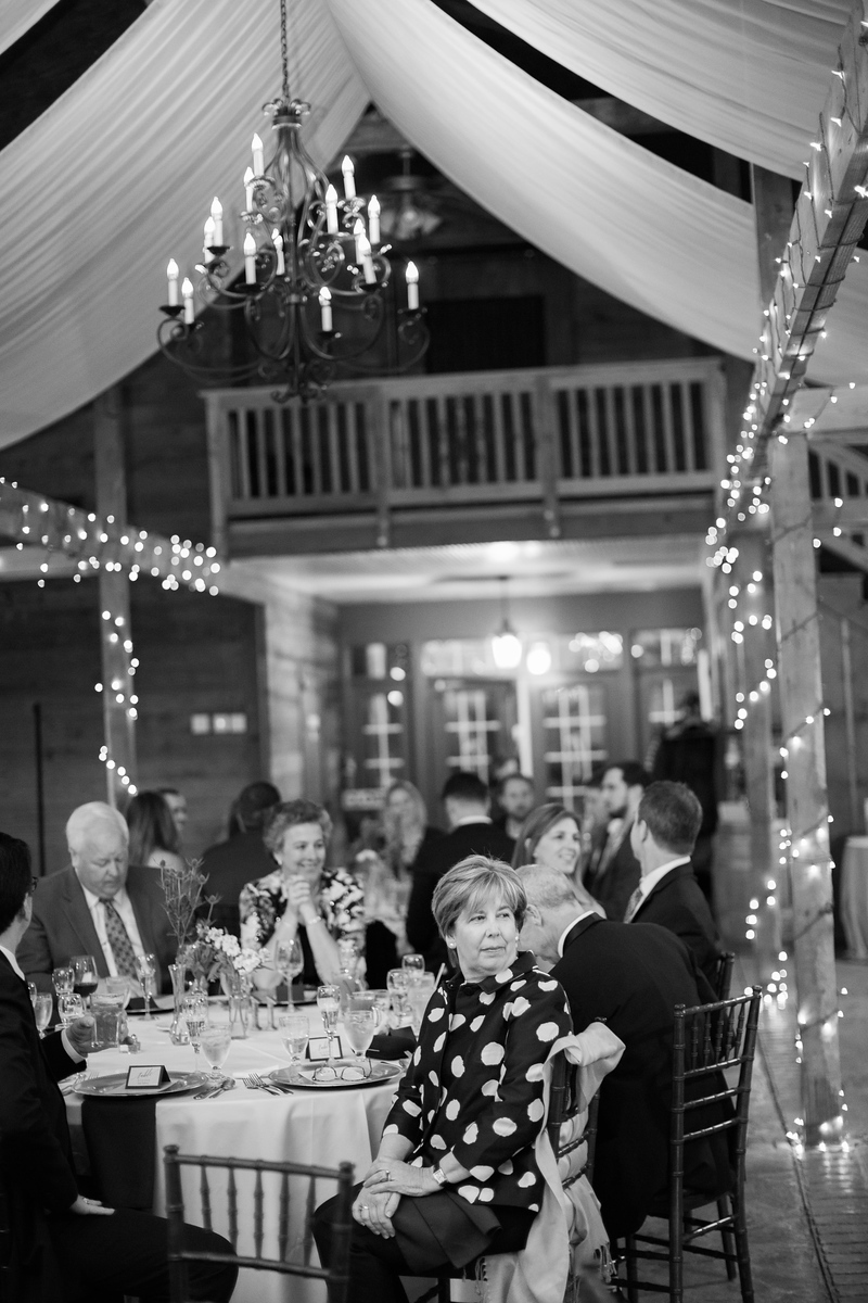 Bluemont Vineyards wedding with the lights lit. Photos by the best Washington DC wedding photographer Jalapeno Photography.