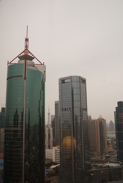 Ophedge building on left and you can see the Shanghai tower in the distance