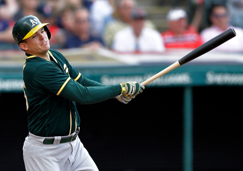 . Oakland Athletics\' Ryon Healy hits a one-run double off Cleveland Indians starting pitcher Trevor Bauer in the fourth inning of a baseball game, Tuesday, May 30, 2017, in Cleveland. Khris Davis scored on the play. (AP Photo/Tony Dejak)