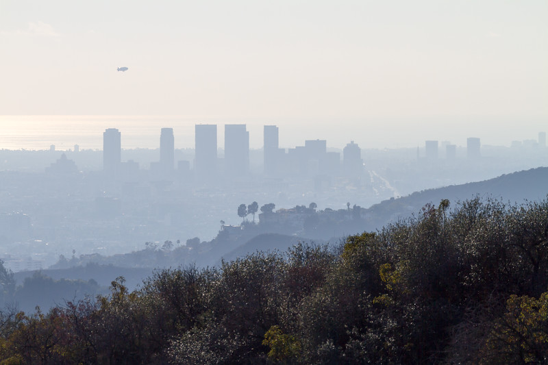 View of Santa Monic buildings and hills from Hollywood Sign with smog - USA - California - Los Angeles