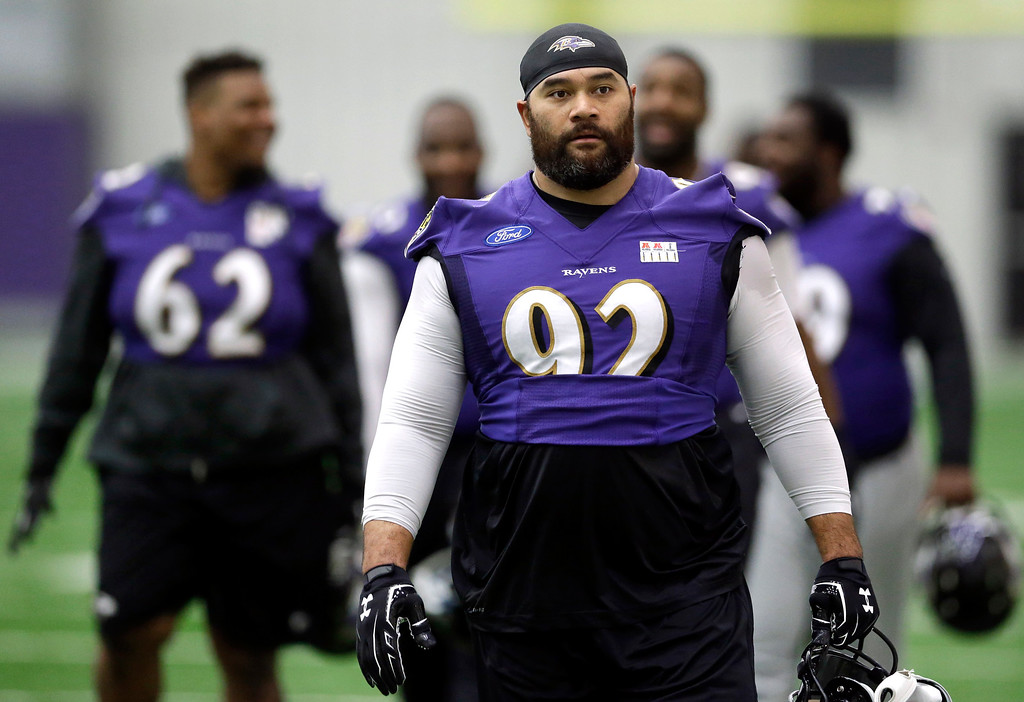 . Baltimore Ravens defensive end Haloti Ngata walks off the field after NFL football practice, Tuesday, Dec. 30, 2014, in Owings Mills, Md. Ngata is returning from a four-game suspension for using the amphetamine Adderall. The Ravens will travel to Pittsburgh for a wild-card game against the Steelers on Saturday. (AP Photo/Patrick Semansky)