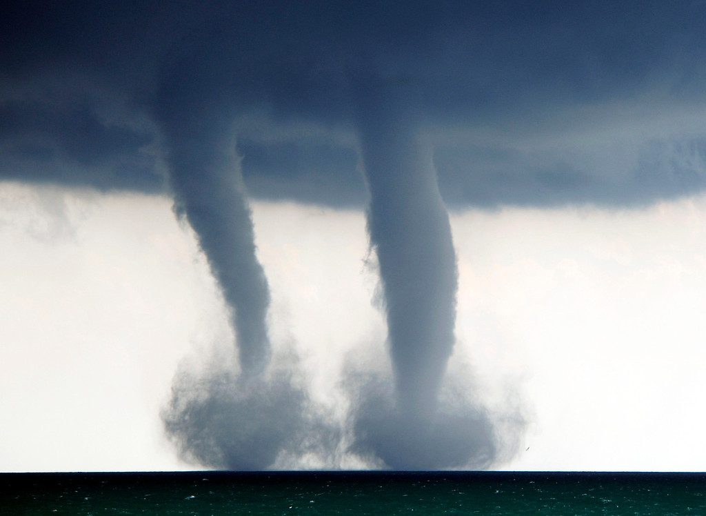 . A pair of water spouts form on Lake Michigan southeast of Kenosha, Wis. on Thursday, Sept. 12, 2013. The National Weather Service in Sullivan said the water spouts occurred about four miles southeast from Kenosha.  (AP Photo/The Kenosha News, Kevin Poirier)