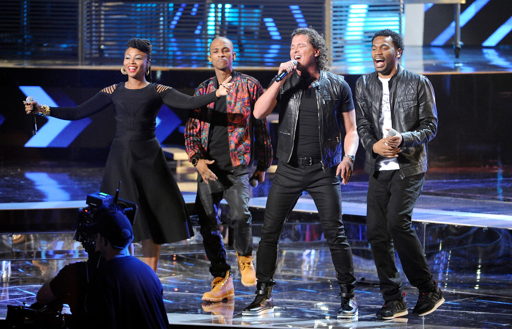 . Carlos Vives, second right, and from left, Gloria Martinez, Miguel Martinez and Carlos Valencia, of the musical group ChocQuibTown, perform at the 15th annual Latin Grammy Awards at the MGM Grand Garden Arena on Thursday, Nov. 20, 2014, in Las Vegas. (Photo by Chris Pizzello/Invision/AP)