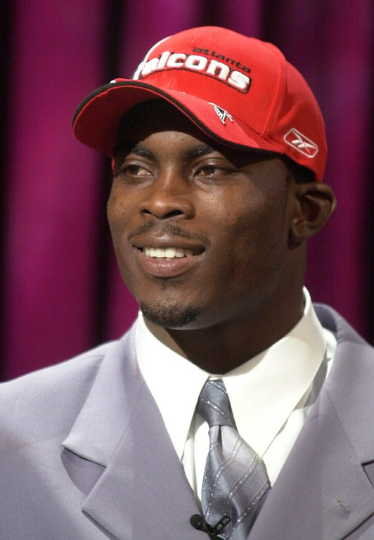 . Michael Vick, Virginia Tech Selected first overall by the Falcons in 2001 Vick went from the most electrifying man in football to one of the most hated men in football when he was jailed following the 2006 season for his involvement in a dog-fighting ring. He returned in 2009 as a backup for Philadelphia, and earned the starting role in 2010. He has struggled to stay healthy in four years with the team, though, and his Eagles missed the playoffs each of the last two seasons. GRADE: B. Had he avoided a detour to prison in his prime, he could have been a Hall of Famer.(AP Photo/Ed Betz)