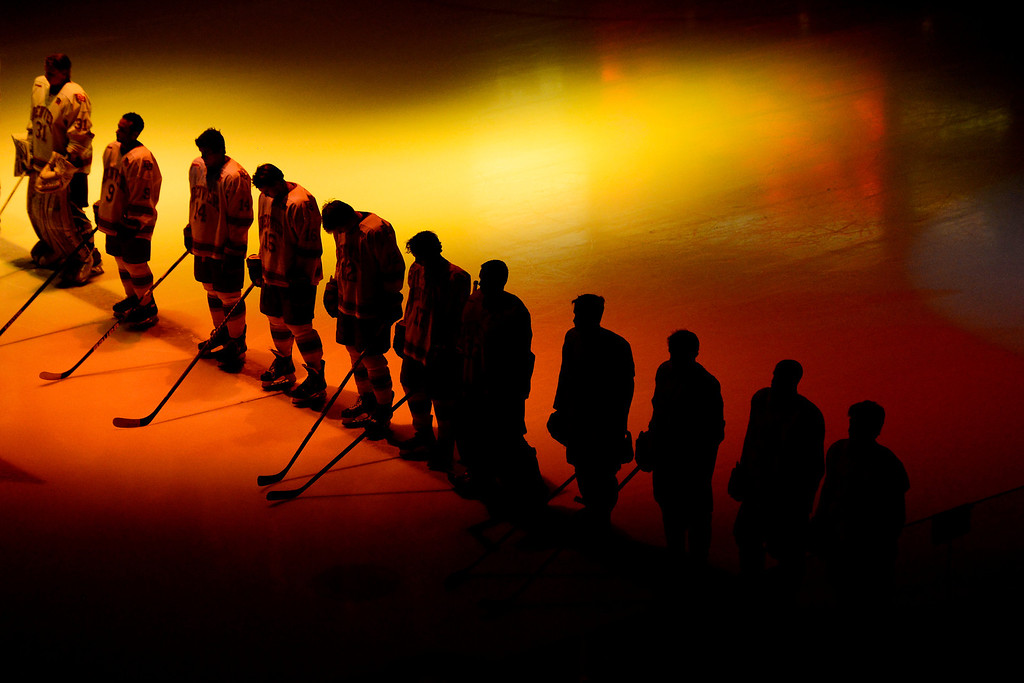 . DENVER, CO - MARCH 17: The University of Denver Pioneers stand for the National Anthem before the first period of action. The University of Denver and Colorado College face off in the WCHA playoffs at Magness Arena. (Photo by AAron Ontiveroz/The Denver Post)