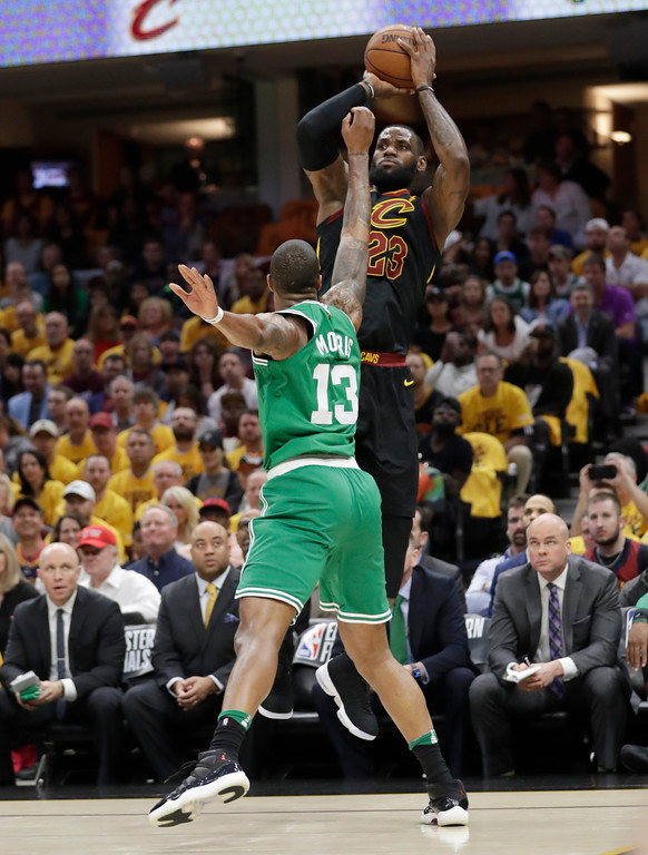 . Cleveland Cavaliers\' LeBron James (23) shoots as Boston Celtics\' Marcus Morris (13) defends in the first half of Game 3 of the NBA basketball Eastern Conference finals, Saturday, May 19, 2018, in Cleveland. (AP Photo/Tony Dejak)