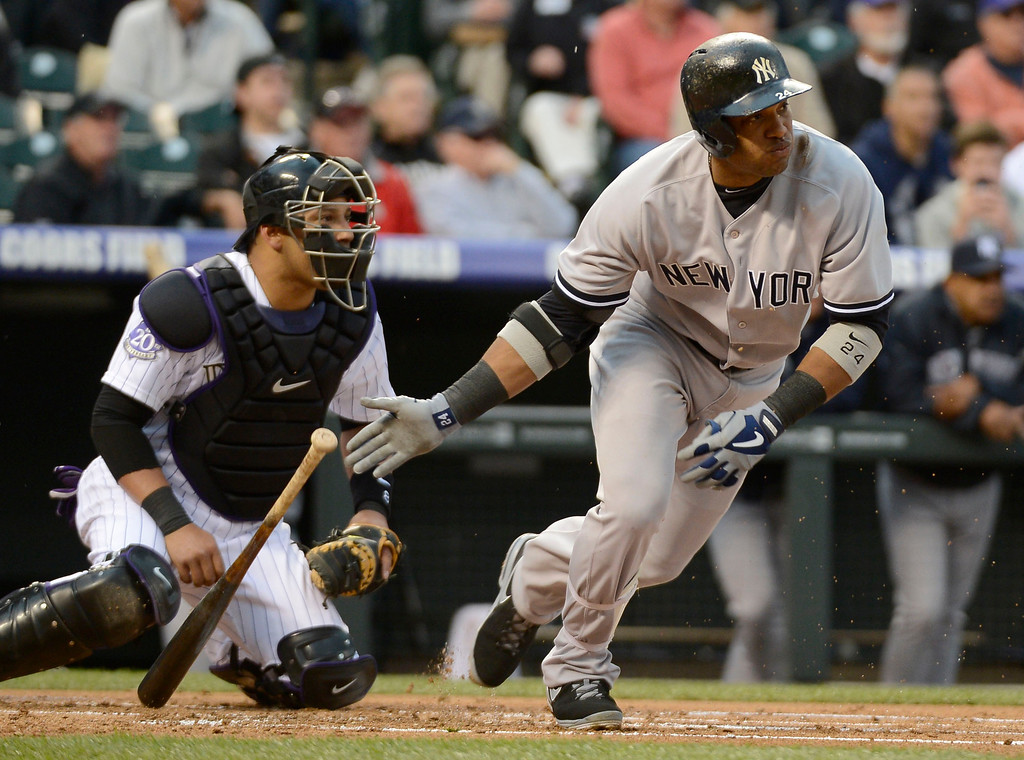 . DENVER, CO. - MAY 07: Robinson Cano (24) of the New York Yankees drops his bat after a soft grounder to Josh Rutledge (14) of the Colorado Rockies to throw him out at first during the first inning May 7, 2013 at Coors Field. (Photo By John Leyba/The Denver Post)