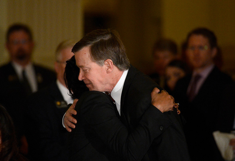 . Colorado Governor John Hickenlooper hugs Kathy Nesbitt, DPA Executive Director during a press conference at the State House in Denver, Colorado on March 20, 2013 to discuss the death of Tom Clements, executive director of the Colorado Department of Corrections. Clements was shot and killed in his Monument, Colorado home on Tuesday, March 19, 2013. (Photo By RJ Sangosti/The Denver Post)