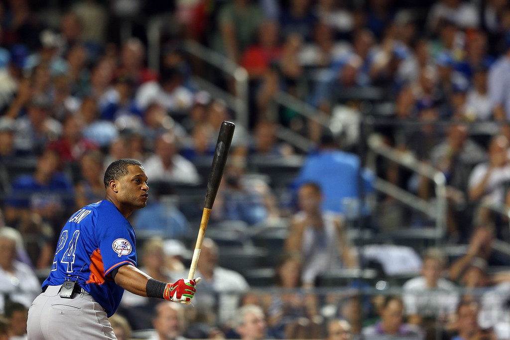 . Robinson Cano of the New York Yankees bats during the Chevrolet Home Run Derby on July 15, 2013 at Citi Field in the Flushing neighborhood of the Queens borough of New York City.  (Photo by Mike Ehrmann/Getty Images)