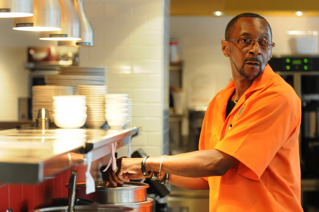 . Henry Wallace checks on some food while in a culinary training program at Frogtown\'s Daily Diner. Wallace, 60, has been in training at the diner for a couple of weeks after being homeless and jobless for more three years. (Pioneer Press: Jean Pieri)