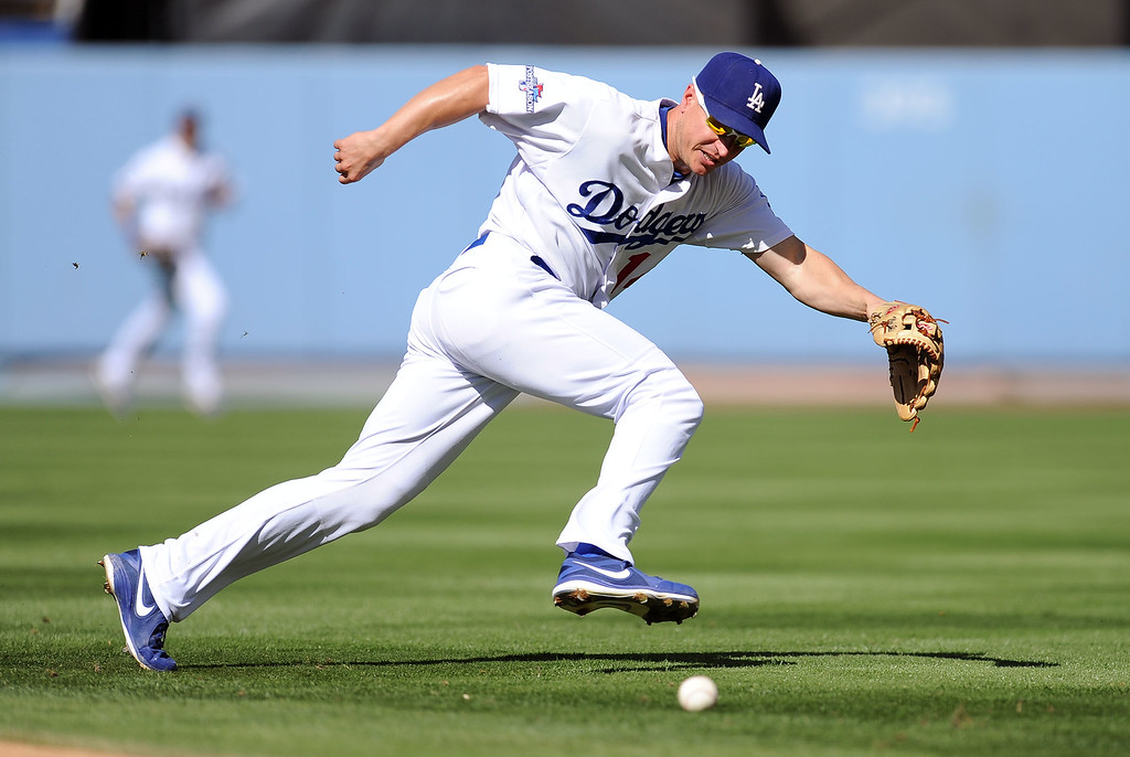 . The Dodgers\' Mark Ellis can\'t get to a groundball in the 3rd inning against the Cardinals during game 5 of the NLCS at Dodger Stadium Wednesday, October 16, 2013.(Hans Gutknecht/Los Angeles Daily News)