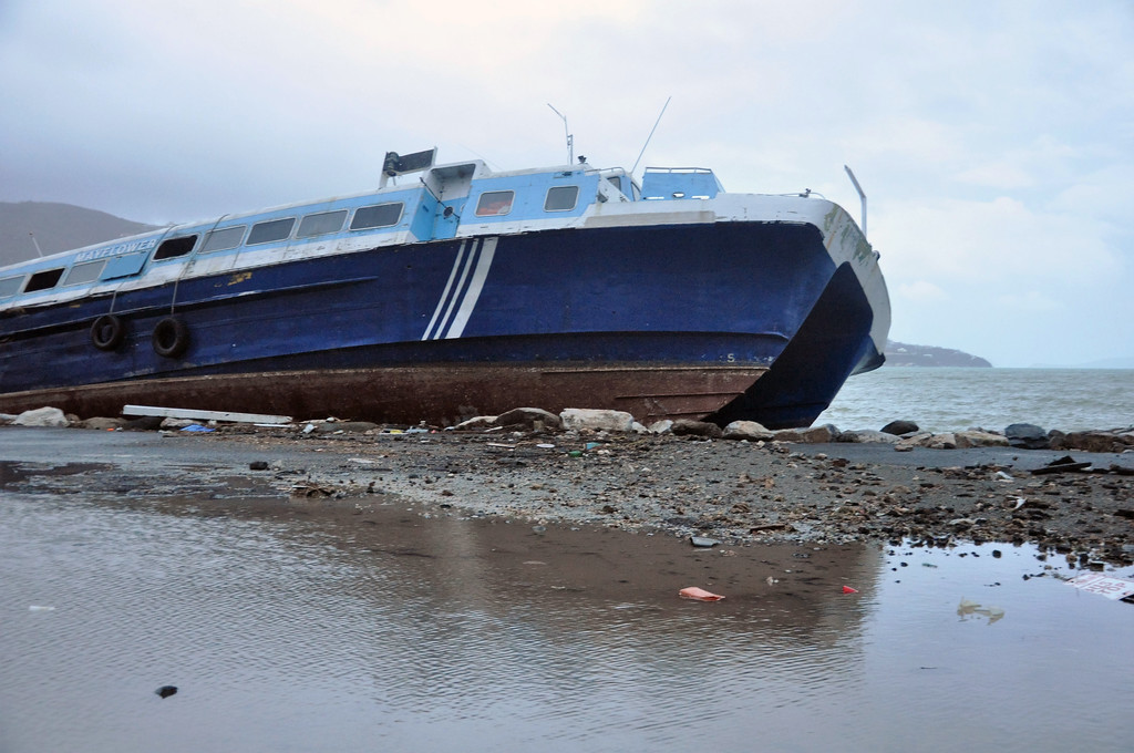 . A ferry beached last week by Hurricane Irma in Road Town, Tortola, the capital of the British Virgin Islands, remained unmoved after Hurricane Maria passed, early Wednesday, Sept. 20, 2017. (AP Photo/Freeman Rogers)