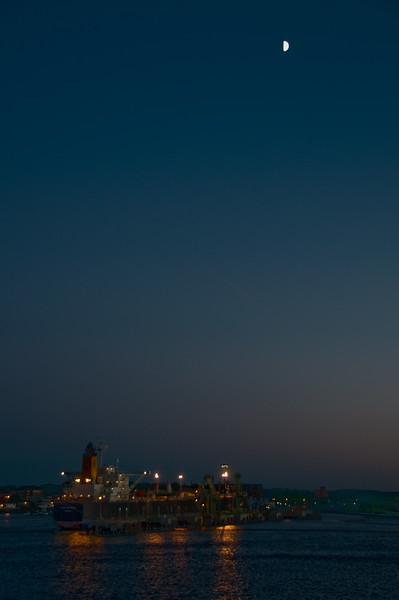 Half moon at dusk.