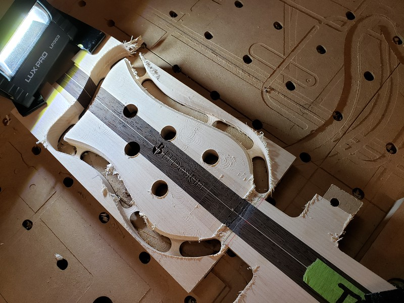 Machined headstock after facing, hole boring, profiling and V-carving