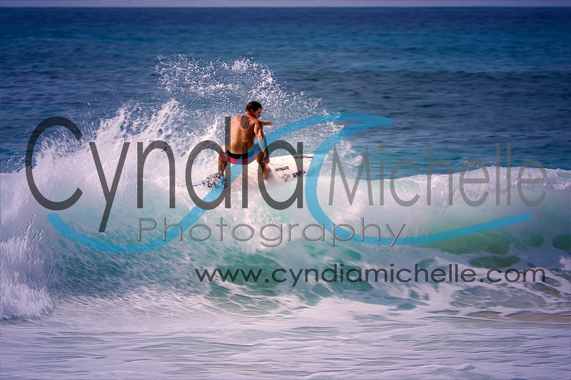 Lifeguard Tim Brandon surfing the South Shore at Sandy Beach, Oahu, Hawaii on October 23, 2014