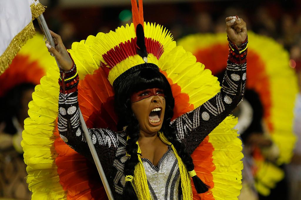 . A performer from the Imperatriz Leopoldinense samba school parades during Carnival celebrations at the Sambadrome in Rio de Janeiro, Brazil, Monday, Feb. 27, 2017. (AP Photo/Leo Correa)