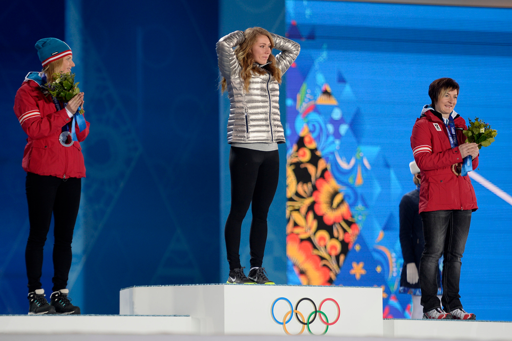 Description of . American Mikaela Shiffrin reacts to being named the gold medalist as Austrian silver medalist Marlies Schild (left) and Austrian bronze medalist Kathrin Zettel flank her on the podium during the ladies' slalom medals ceremony. Sochi 2014 Winter Olympics on Friday, February 22, 2014 at Sochi Olympic Park. (Photo by AAron Ontiveroz/ The Denver Post)