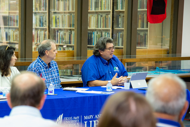 """Dr. Dan Jorgensen gives his presentation during the """"100 Years After The Storm"""" forum."""