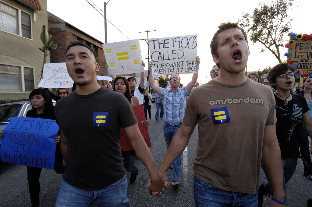 . LONG BEACH, CALIF. -- Rick Carpiso, left, and Matt Huisman join marchers on Broadway headed a mile east to Bixby Park in Long Beach, Calif. on May 27, 2009. Carpiso and Huisman are partners but not married. The protesters are upset that the California Supreme Court upheld Proposition 8 banning gay marriage.     Photo by Jeff Gritchen/Long Beach Press-Telegram