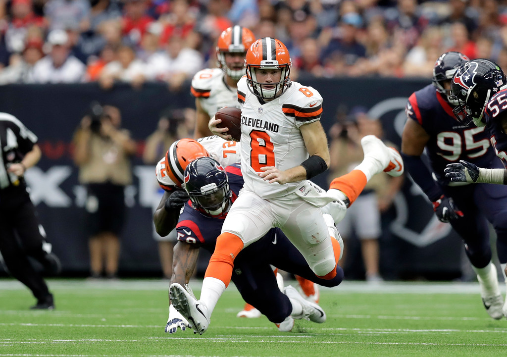 . Cleveland Browns quarterback Kevin Hogan (8) runs the ball against the Houston Texans in the second half of an NFL football game, Sunday, Oct. 15, 2017, in Houston. (AP Photo/Eric Gay)