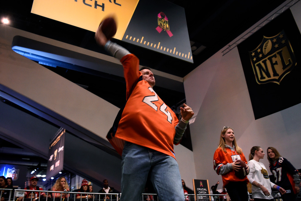 . SAN FRANCISCO, CA - FEBRUARY 05: Chad Kosmicki concentrates makes his throw in the Critical Catch game as his daughter, 13 year old Hannah waits for her turn at the NFL Experience in downtown San Francisco, CA. February 05, 2016 (Photo by Joe Amon/The Denver Post)
