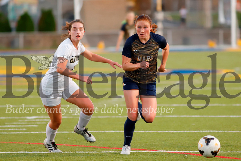 Mars midfielder Ellie Coffield (#3) charges past Gateway's  Anna Reynolds (#23). Coffield scored Mars first goal. Seb Foltz/Butler Eagle