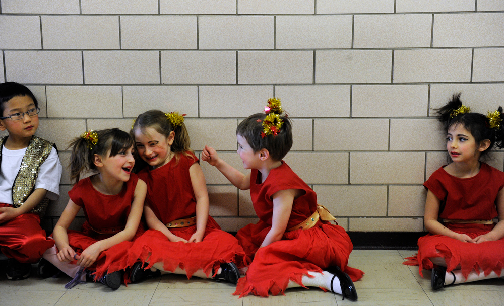 . Kindergarteners wait in the hall to perform their Xin Nian Hao dance. Students at the Denver Language School ring in the Year of the Snake with their Chinese New Year celebration performance in the school auditorium. Kindergarteners through 4th grade perform traditional dances dressed in colorful Chinese costumes. According to the school principal, Chinese New Year is the most important of the traditional Chinese holidays. Families make way for  good luck by cleaning their homes symbolizing reconciliation and forgetting old grudges in exchange for peace and happiness. The Chinese New Year (Feb. 10) follows the Chinese 12 Zodiac Calendar Year designating 2013 the Year of the Snake. (Photo By Kathryn Scott Osler/The Denver Post)