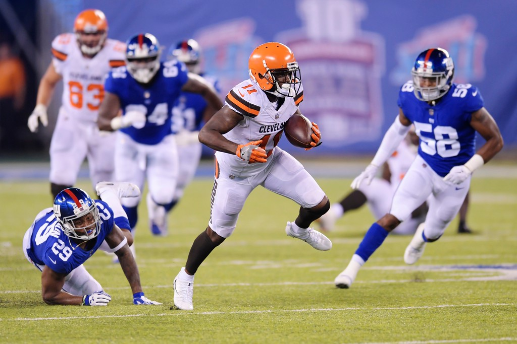 . Cleveland Browns\' Antonio Callaway (11) runs away from New York Giants Leonard Johnson (29) and Tae Davis (58) for a touchdown during the second half of a preseason NFL football game Thursday, Aug. 9, 2018, in East Rutherford, N.J. (AP Photo/Bill Kostroun)