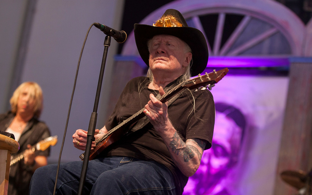 . Johnny Winter performs at the New Orleans Jazz and Heritage Festival in New Orleans on Saturday, May 3, 2014. Winter died on July 16, 2014. He was 70. Leave a message to remember Winter: http://bit.ly/1mK1aZG  (Photo by Barry Brecheisen/Invision/AP)