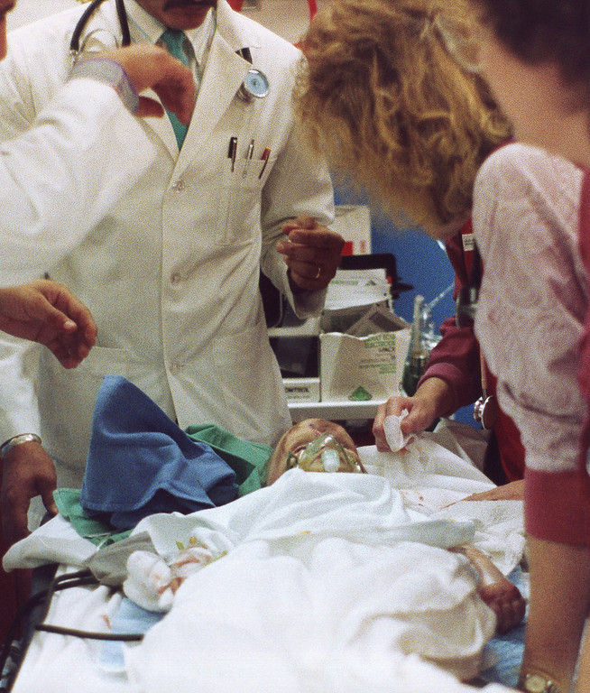 . Doctors and nurses from Midland Memorial hospital look over 18 month old Jessica McClure on Oct. 17, 1987 after she was brought to the hospital after spending more than 50 hours trapped in an abandoned water well in Midland. (AP Photo/John Brennan)