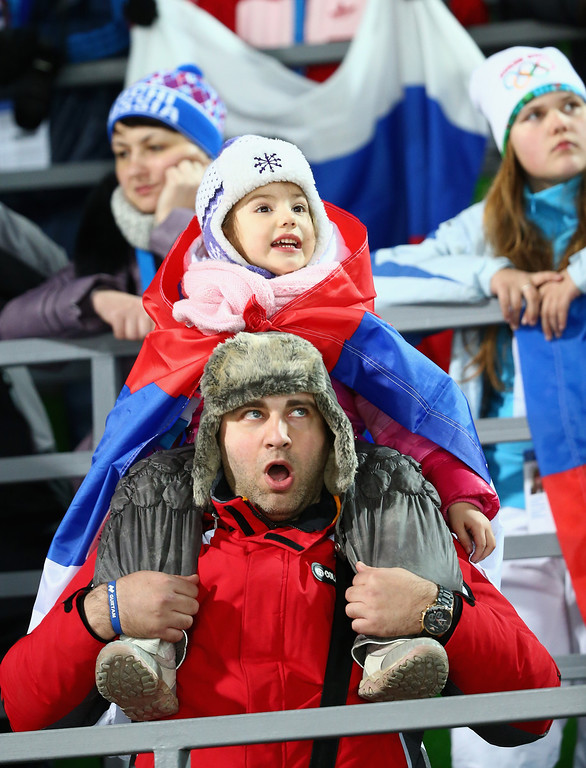 . SOCHI, RUSSIA - FEBRUARY 09:  Russian fans look on during the Men\'s Normal Hill Individual Ski Jumping Final on day 2 of the Sochi 2014 Winter Olympics at RusSki Gorki Jumping Center on February 9, 2014 in Sochi, Russia.  (Photo by Ryan Pierse/Getty Images)