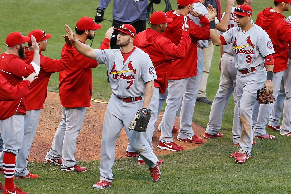 . St. Louis Cardinals\' Matt Holliday (7) and Carlos Beltran (3) celebrate with teammates after the Cardinals defeated the Pittsburgh Pirates in Game 4 of a National League baseball division series, Monday, Oct. 7, 2013, in Pittsburgh. The Cardinals won 2-1 to even the best-of-five series. (AP Photo/Keith Srakocic)