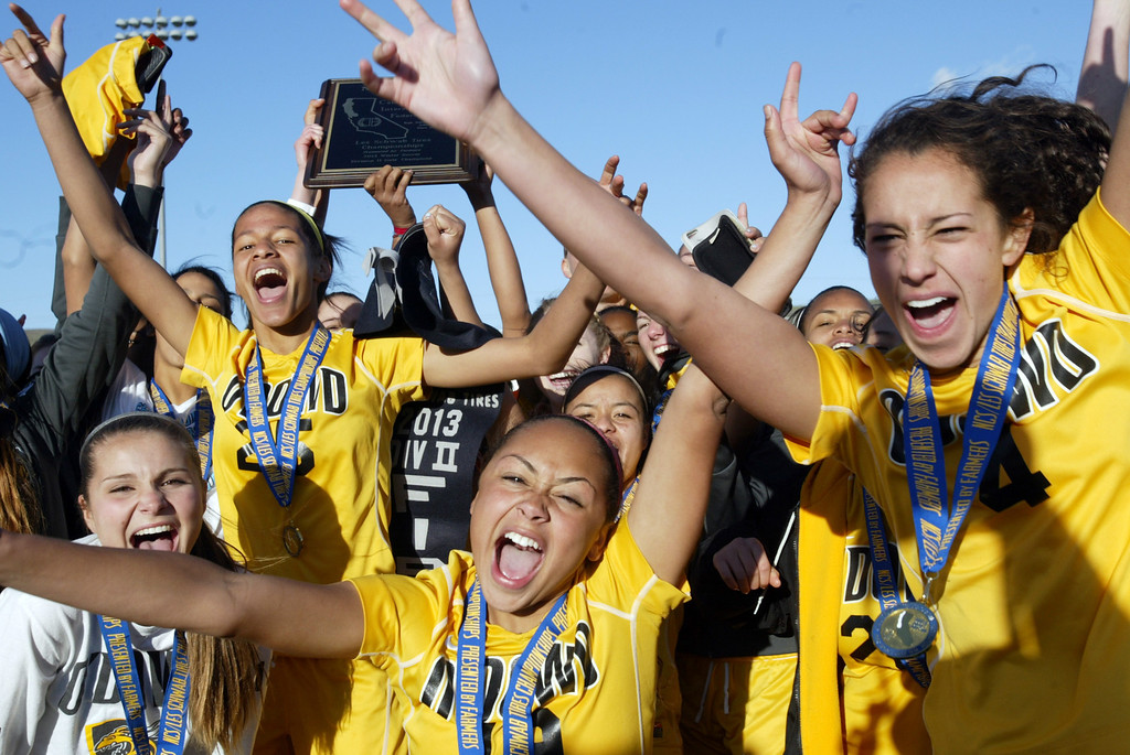. Bishop O\'Dowd soccer players celebrate their North Coast Section Division II Championship against Piedmont at Dublin High School soccer field in Dublin, Calif., on Saturday, Feb. 23, 2013. Bishop O\'Dowd won 3-2 in a series of penalty kicks. (Ray Chavez/Staff)