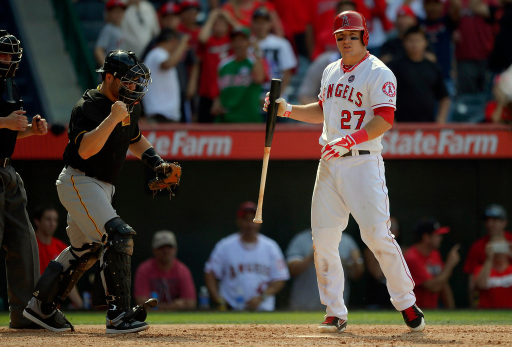 . Pittsburgh Pirates catcher Russell Martin, second from left, celebrates as Los Angeles Angels\' Mike Trout, right, strikes out to end a baseball game during the 10th inning on Sunday, June 23, 2013, in Anaheim, Calif.  (AP Photo/Mark J. Terrill)