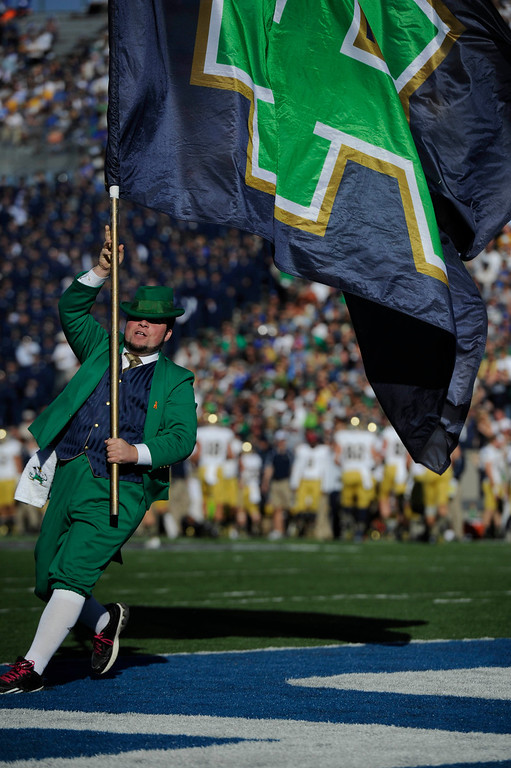 . COLORADO SPRINGS, CO - OCTOBER 26: The Notre Dame leprechaun flies the Fighting Irish flag in the end zone after Corey Robinson,  scored a touchdown against the Air Force Falcons in the first quarter of play at Falcons Stadium Saturday afternoon, October 26, 2013. (Photo By Andy Cross/The Denver Post)