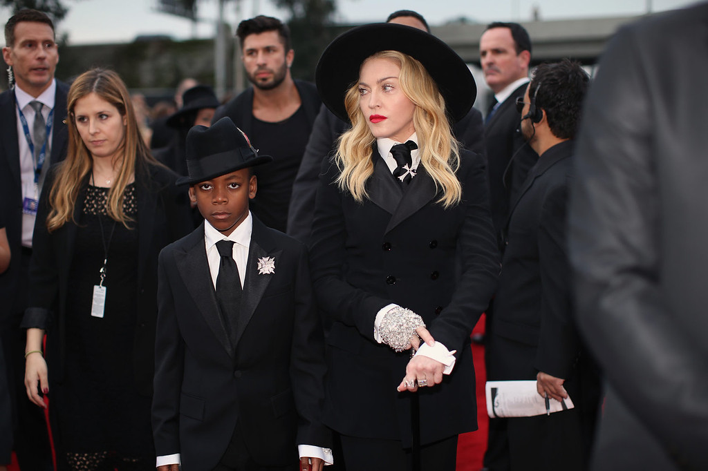 . Singer Madonna (R) and son David Banda Mwale Ciccone Ritchie attend the 56th GRAMMY Awards at Staples Center on January 26, 2014 in Los Angeles, California.  (Photo by Christopher Polk/Getty Images for NARAS)