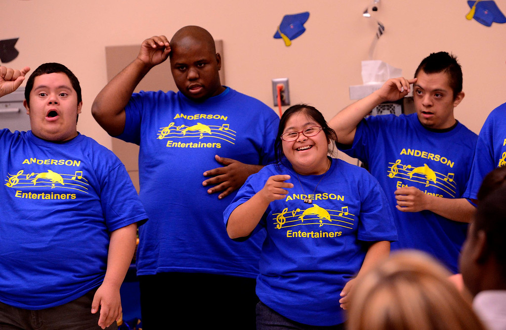 . Daisy Pineda, second from right, performs with the Anderson Entertainers during Commencement Ceremonies at Carl And Dora Anderson School in San Bernardino May 21, 2013.  Seventeen developmentally disabled students graduated from the school.  GABRIEL LUIS ACOSTA/STAFF PHOTOGRAPHER.