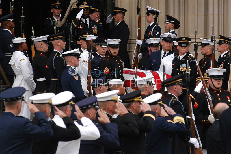 Joint Chiefs of Staff salute   Ronald Reagan's casket as he  is taken to the hearse during the state funeral