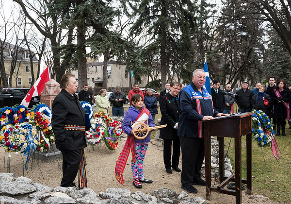 President of the Manitoba Metis Federation David Chartrand speaks alongside his granddaughter Martha who holds a copy of the historical framework agreement with the Government of Canada at Louis Riel's grave site Wednesday November 16, 2016 during the Louis Riel Commemoration Ceremony at the St. Boniface Basilica Grounds. (David Lipnowski for Metro News)