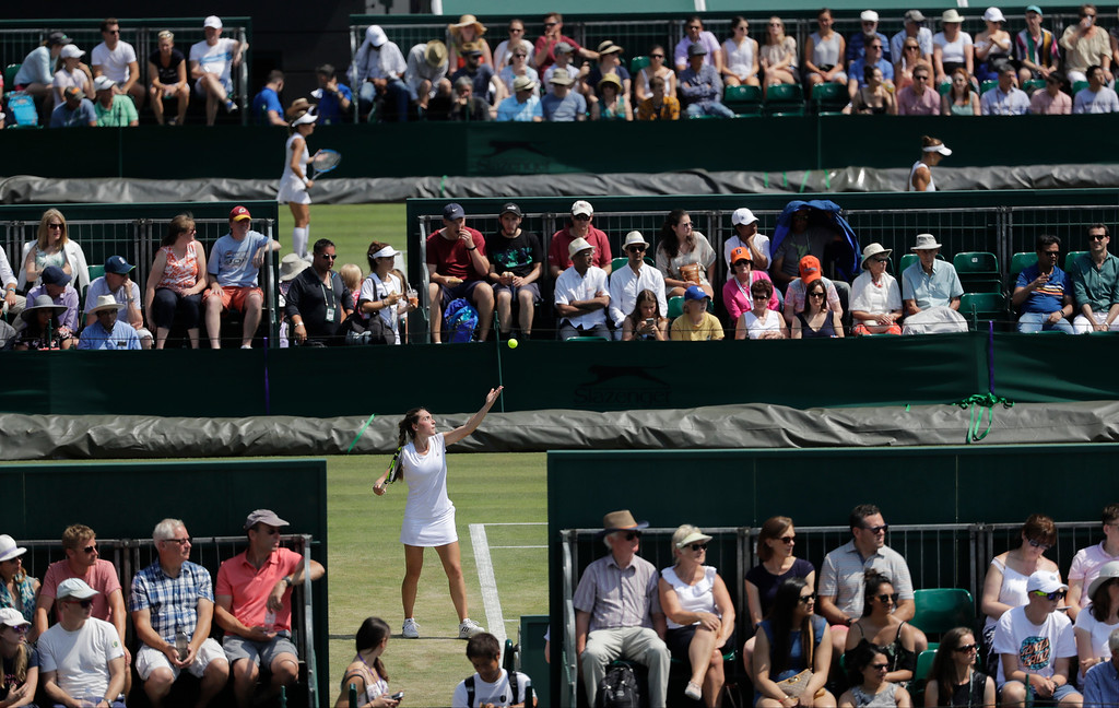 . Eleonora Molinaro of Luxembourg serves to Natasha Subhash of the US during their girls\' singles match on the sixth day at the Wimbledon Tennis Championships in London, Saturday July 7, 2018. (AP Photo/Ben Curtis)