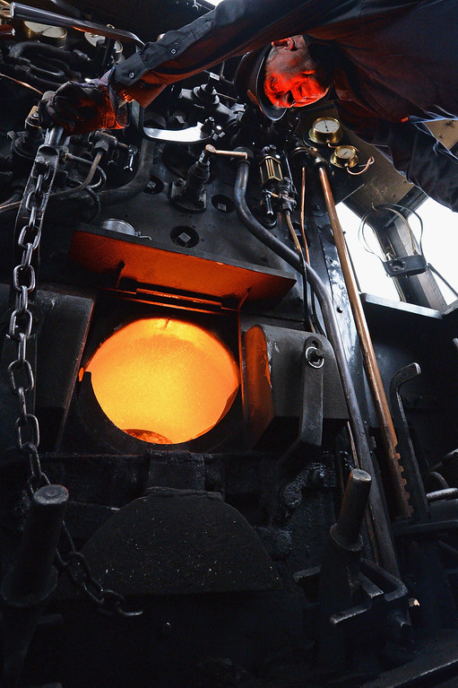 . Fireman Ken Plant stokes the boiler on the 1952 British Rail Ivatt number 46512 at Strathspey Steam Railway on August 27, 2013 in Aviemore, Scotland.   (Photo by Jeff J Mitchell/Getty Images)