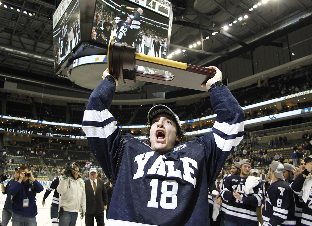 . PITTSBURGH, PA - APRIL 13:  Kenny Agostino #18 of the Yale Bulldogs celebrates after defeating the Quinnipiac Bobcats in the Men\'s Ice Hockey National Championship game at Consol Energy Center on April 13, 2013 in Pittsburgh, Pennsylvania.  Yale defeated Quinnipiac 4-0.  (Photo by Justin K. Aller/Getty Images)