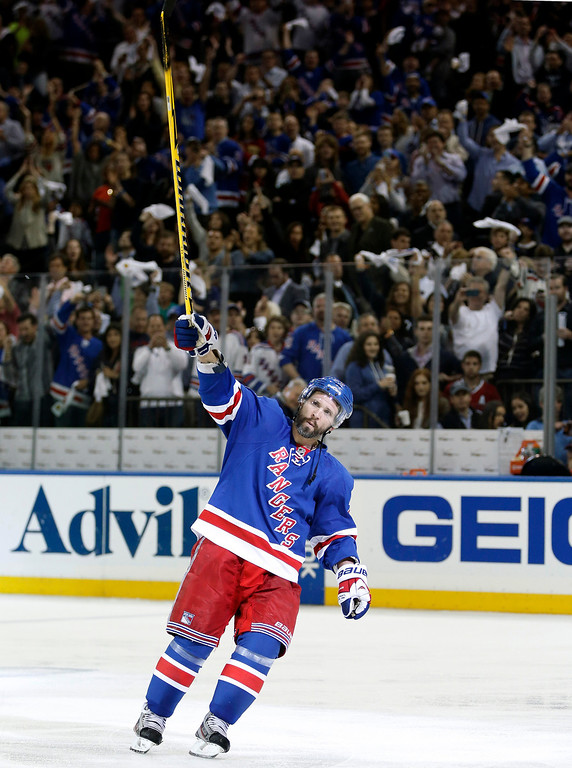 . New York Rangers right wing Martin St. Louis (26) celebrates his game-winning goal in overtime of Game 4 of the NHL hockey Stanley Cup playoffs Eastern Conference finals, Sunday, May 25, 2014, in New York. The Rangers defeated the Canadiens 3-2 to go up 3-1 in the series. (AP Photo/Kathy Willens)