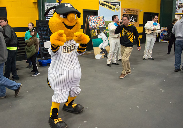 05/03/19 Wesley Bunnell | Staff The New Britain Bees home opener vs the Somerset Patriots on Friday night at New Britain Stadium. Mascot Sting motions for the camera as GM Brad Smith walks in front of a mariachi band from Cirque Du Soleil Luzia who performed for fans.