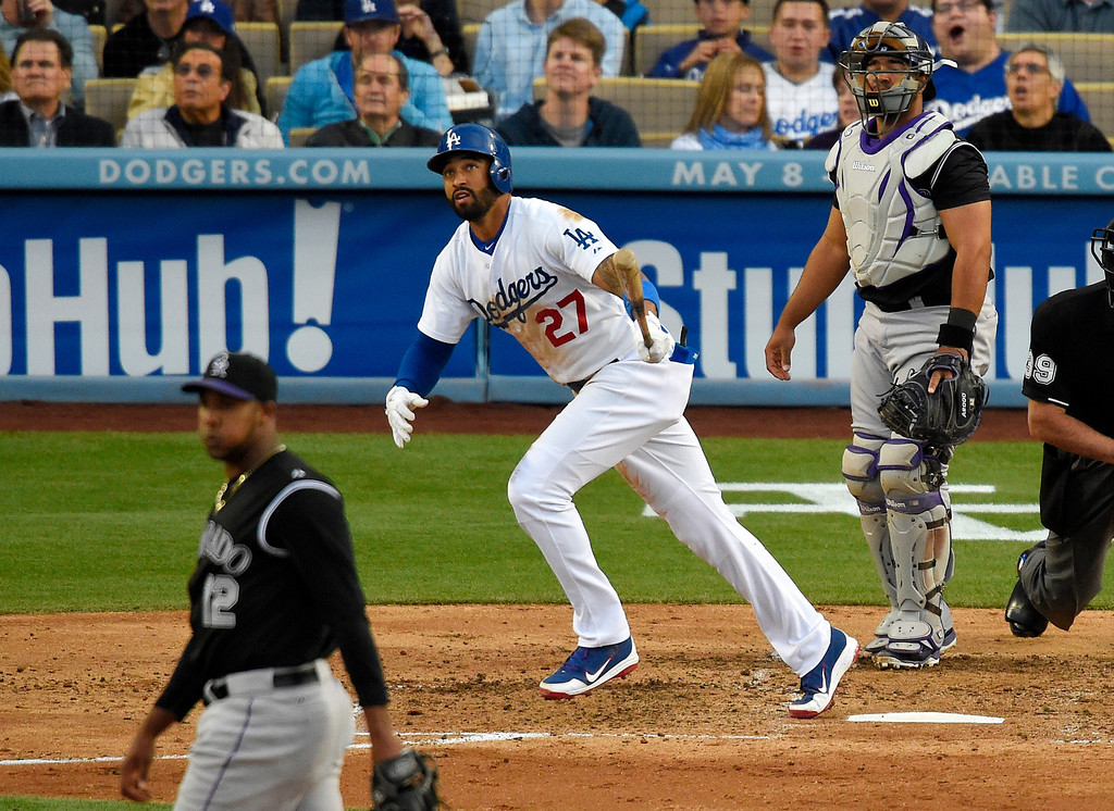 . Los Angeles Dodgers\' Matt Kemp, center, watches his solo home, between Colorado Rockies starting pitcher Juan Nicasio, left, and catcher Wilin Rosario during the third inning of a baseball game, Saturday, April 26, 2014, in Los Angeles. (AP Photo/Mark J. Terrill)