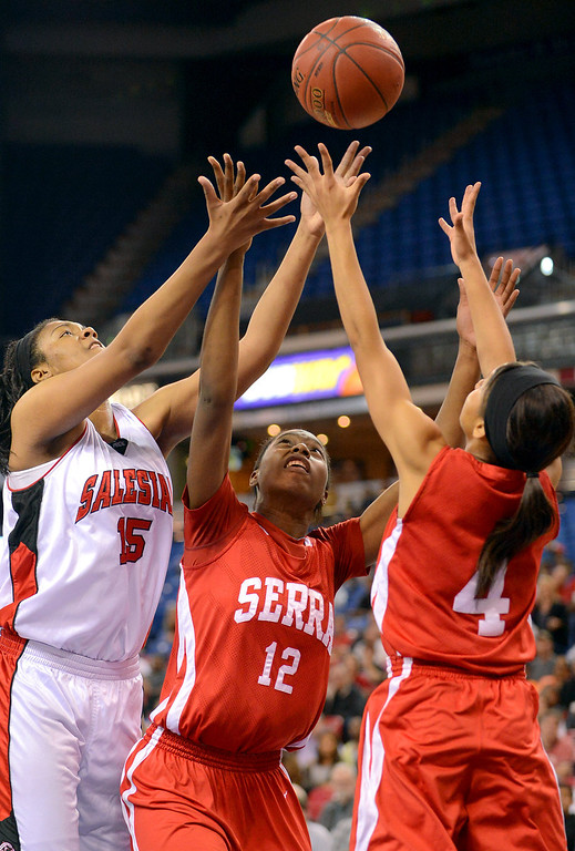 . Serra High School\'s Tatiana Howard and Deandrea Toler battle for a rebound with Zoe Correal of Salesian High during the Division IV 2013 CIF State Basketball Championships at Sleep Train Arena, in Sacramento, Ca March 23, 2013.  Serra won the game 62-60.(Andy Holzman/Los Angeles Daily News)