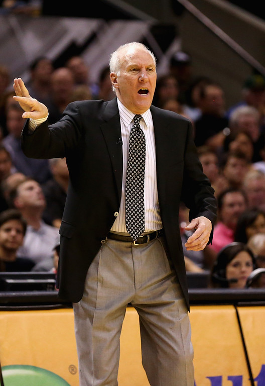 . Head coach Gregg Popovich of the San Antonio Spurs gestures from the bench in the second quarter against the Oklahoma City Thunder during Game Five of the Western Conference Finals of the 2014 NBA Playoffs at AT&T Center on May 29, 2014 in San Antonio, Texas.   (Photo by Ronald Martinez/Getty Images)