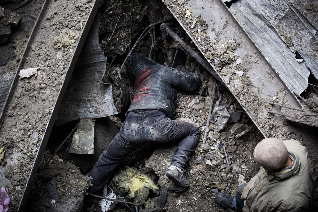 . DONETSK, UKRAINE - FEBRUARY 26:  Ukrainian soldier prisoners-of-war are forced by pro-Russian rebels to search through the wreckage of the destroyed Donetsk airport for weaponry and dead bodies on February 26, 2015 in Donetsk, Ukraine. The Donetsk airport has been one of the most heavily fought over pieces of land between the Ukrainian army and pro-Russian rebels.  (Photo by Andrew Burton/Getty Images)