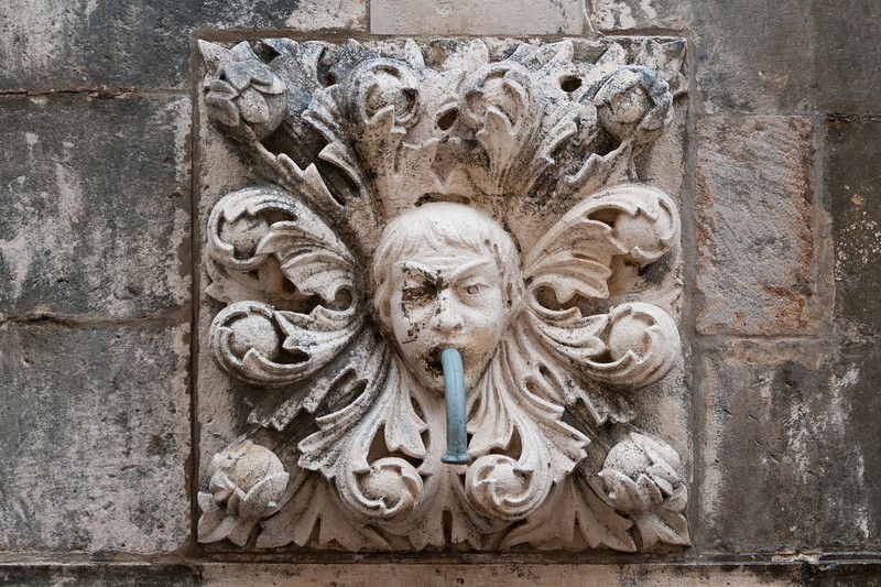 Wall sculpture in Onuphrius' Fountain - Dubrovnik, Croatia